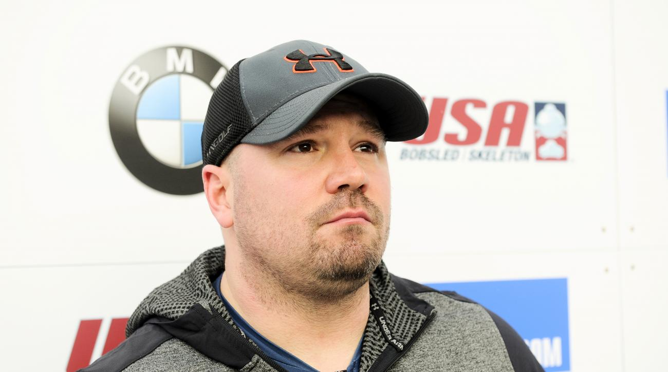 Driver Steven Holcomb, of the United States, talks with reporters in the finish area after winning the mens two-man bobsled World Cup race  on Friday, Dec. 16, 2016, in Lake Placid, N.Y. (AP Photo/Hans Pennink)