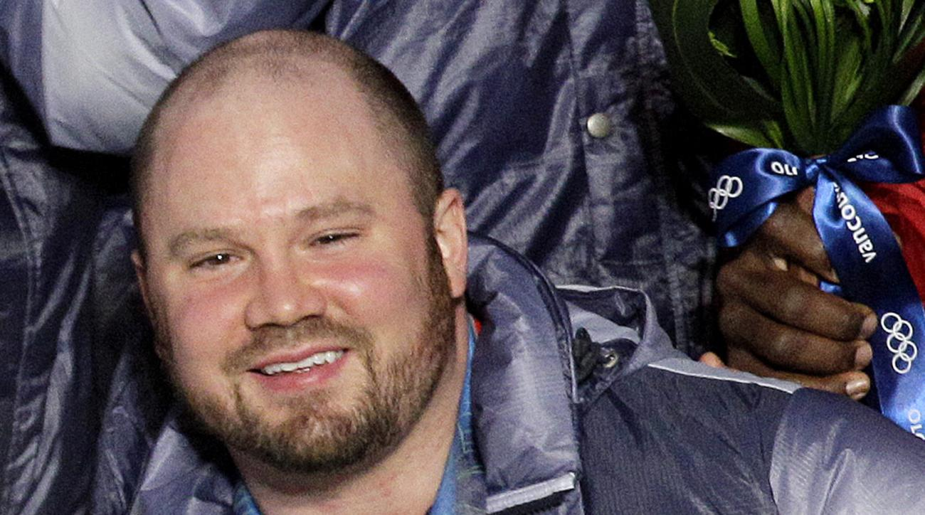 FILE - In this Feb. 27, 2010, file photo, Steven Holcomb, of the United States, poses with his gold medal in the men's four-man bobsled during the medal ceremony at the Vancouver 2010 Olympics in Whistler, British Columbia.  Holcomb, the longtime U.S. bob