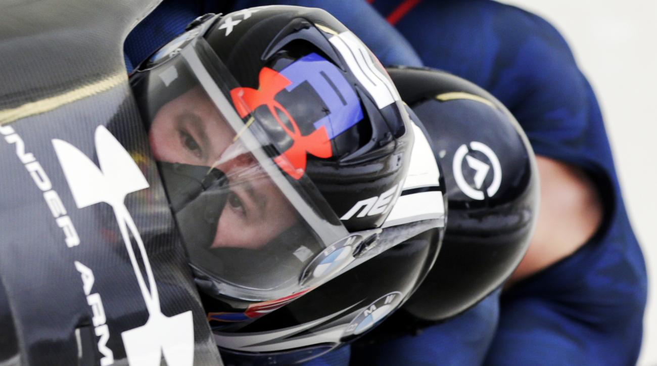 FILE - In this Jan. 9, 2016, file photo, driver Steven Holcomb with Frank Delduca, Carlo Valdes and brakeman Samuel McGuffie, compete in the four-man bobsled World Cup race in Lake Placid, N.Y.  Holcomb, the longtime U.S. bobsledding star who drove to thr