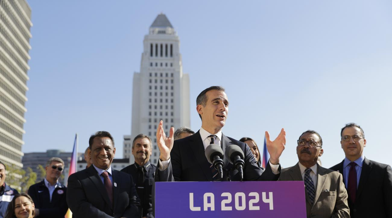 FILE - In this Jan. 25, 2017, file photo, Los Angeles Mayor Eric Garcetti, center, speaks during a news conference in Los Angeles. Los Angeles leaders this week are trying to sell their plan to host the Olympic Games to visiting members of the Internation