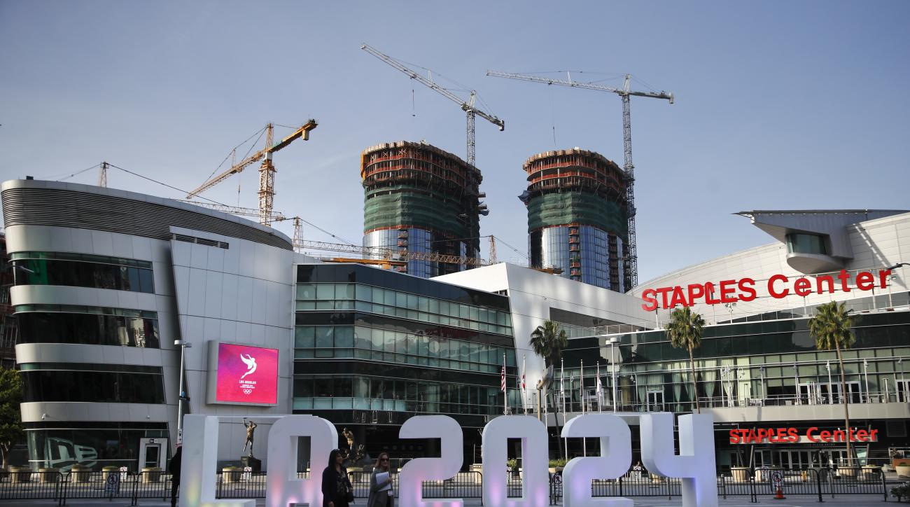 A Los Angeles 2024 sign stands in front of Staples Center Thursday, May 11, 2017, in Los Angeles. After bidding for the 2024 Olympics, Los Angeles might have to wait. With the competition down to LA and Paris, International Olympic Committee leaders are c