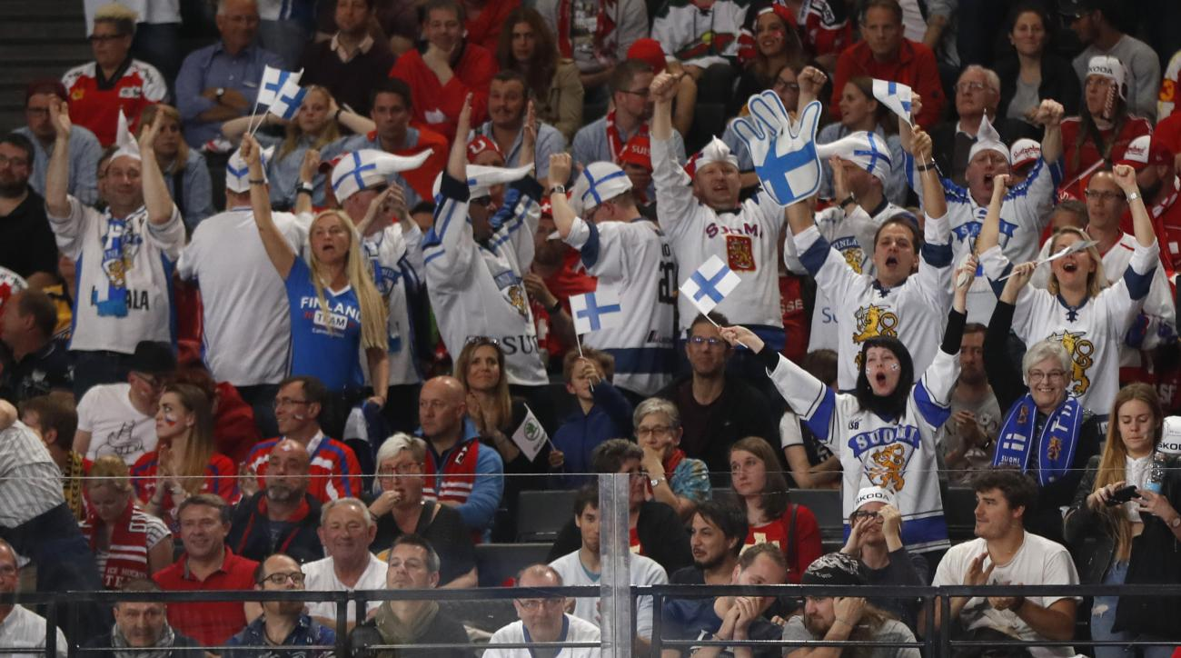 Finland's fans and players celebrate after scoring a goal during the Ice Hockey World Championships group B match between Switzerland and Finland in the AccorHotels Arena in Paris, France, Sunday, May 14, 2017. (AP Photo/Petr David Josek)