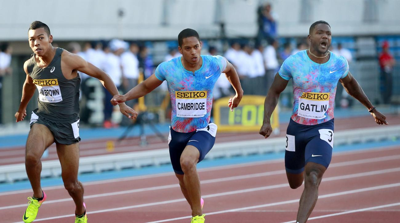Justin Gatlin, right, of the United States competes ahead of Aska Cambridge, center, and Abdul Hakim Sani Brown of Japan at the men's 100 meters at the Golden Grand Prix track and field event in Kawasaki, near Tokyo, Sunday, May 21, 2017. Gatlin clocked 1