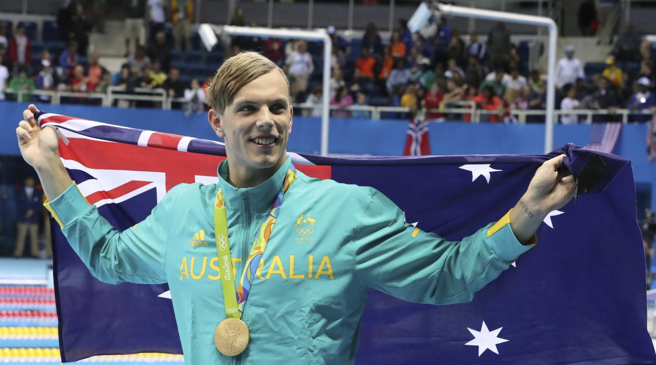 FILE - In this Aug. 11, 2016 file photo, Australia's Kyle Chalmers celebrates after winning his gold medal after the men's 100-meter freestyle during the swimming competitions at the 2016 Summer Olympics, in Rio de Janeiro, Brazil. Chalmers has withdrawn