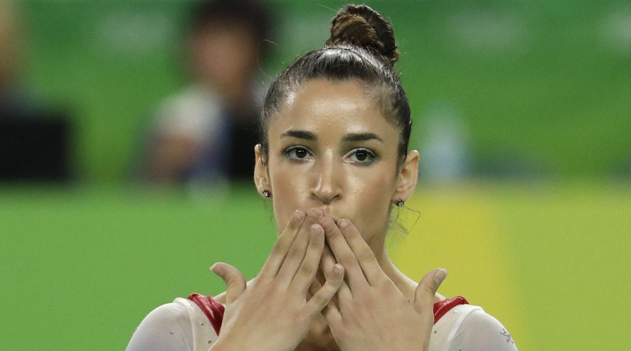United States' Aly Raisman completes her routine on the floor during the artistic gymnastics women's apparatus final at the 2016 Summer Olympics in Rio de Janeiro, Brazil, Tuesday, Aug. 16, 2016. (AP Photo/Dmitri Lovetsky)