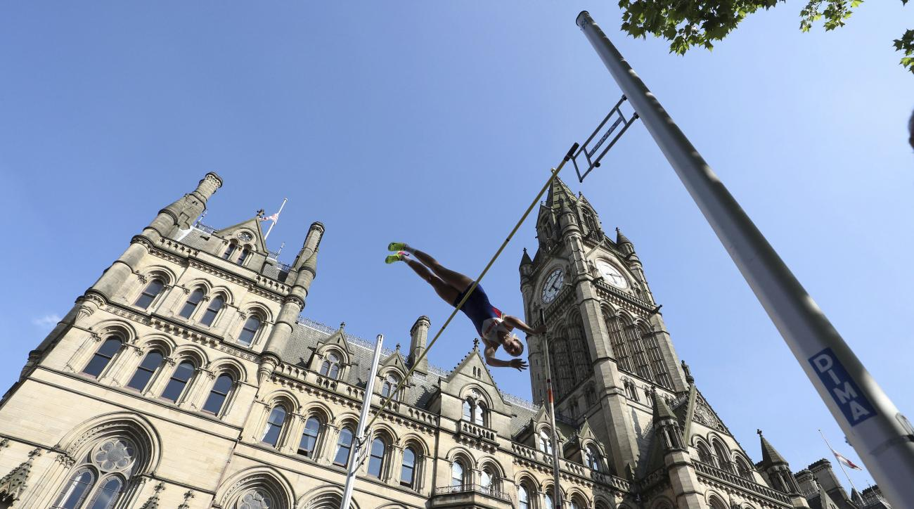 Britain's Holly Bradshaw competes in the Pole Vault during the Great CityGames at Deansgate, in Manchester, England, Friday May 26, 2017. ( Martin Rickett/PA via AP)