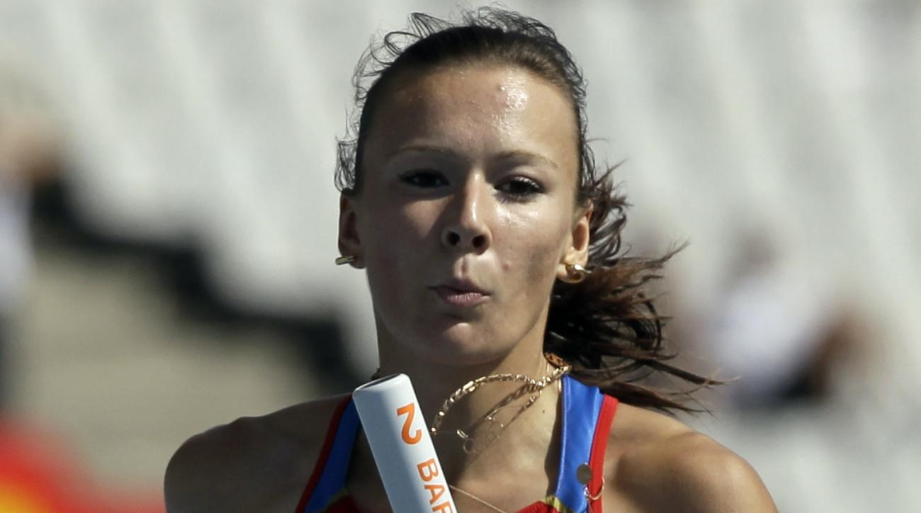 FILE -In this Saturday, July 31, 2010 file photo, Russia's Yulia Chermoshanskaya competes in a Women's 4x100m heat during the European Athletics Championships, in Barcelona, Spain. Six Russian and Ukrainian track athletes have been handed doping bans afte