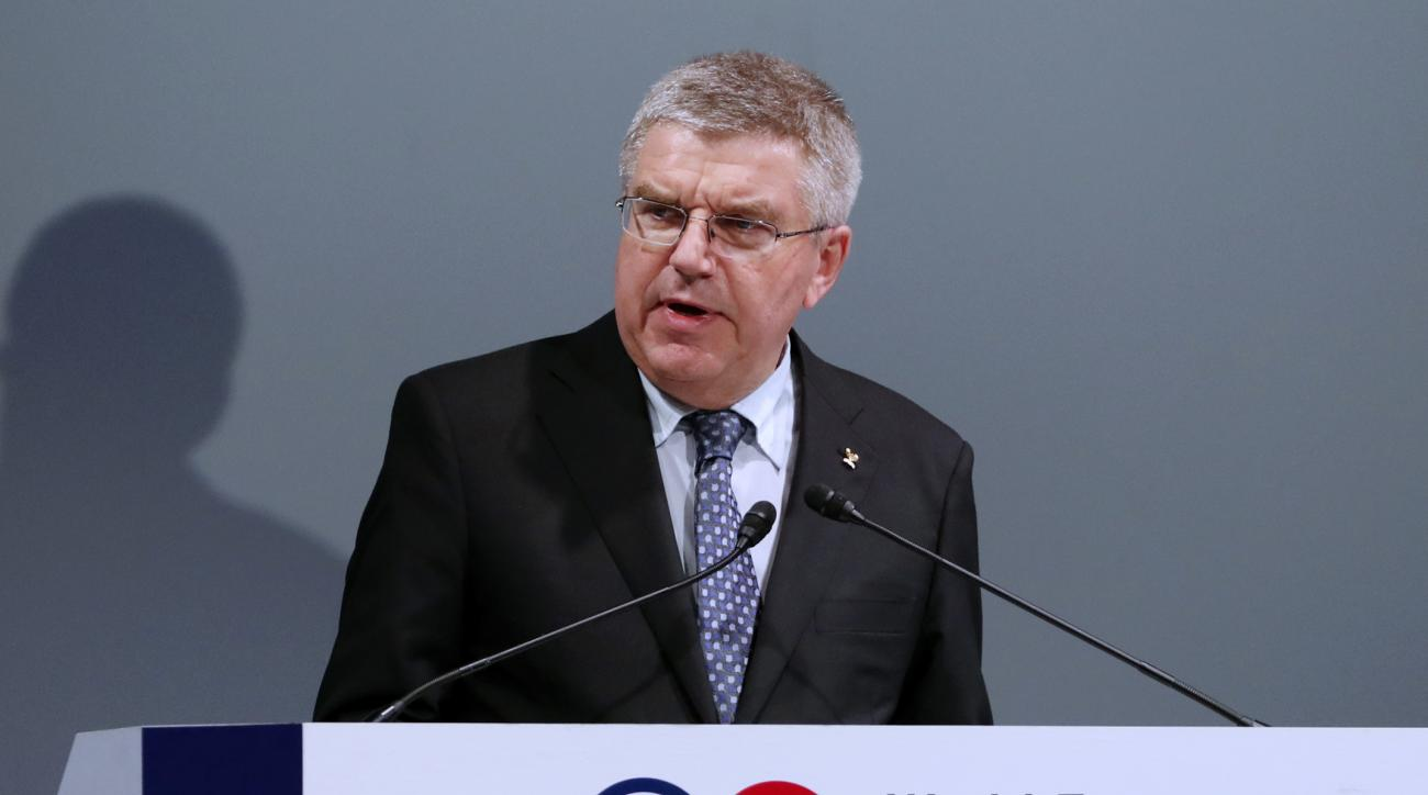 FILE - In this Thursday, Oct. 20, 2016 file photo, International Olympic Committee President Thomas Bach delivers a speech at World Forum on Sports and Culture in Tokyo. Los Angeles and Paris should edge closer Friday, June 9, 2017 to both getting Olympic