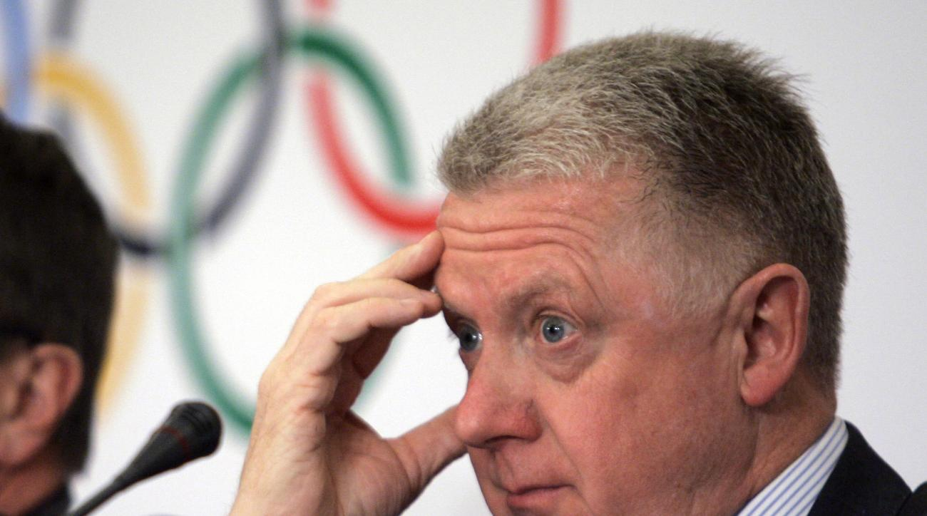 FILE - In this April 3, 2008 file photo, Hein Verbruggen, the then coordination commission chairman of the 2008 Beijing Olympic Organizing Committee, listens during a news conference in Beijing. Former International Cycling Union president Hein Verbruggen