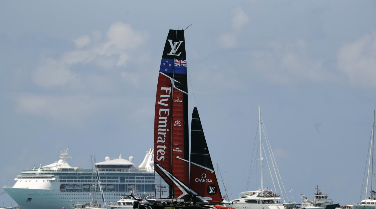 Emirates Team New Zealand passes a gallery of boats as they race Oracle Team USA during America's Cup match sailing competition, Saturday, June 17, 2017, in the Great Sound of Bermuda. (AP Photo/Gregory Bull)
