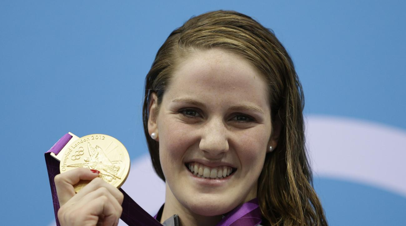 FILE - In this July 30, 2012, file photo, United States' Missy Franklin poses with her gold medal for the women's 100-meter backstroke swimming final at the Aquatics Centre in the Olympic Park during the 2012 Summer Olympics in London. Missy Franklin is s