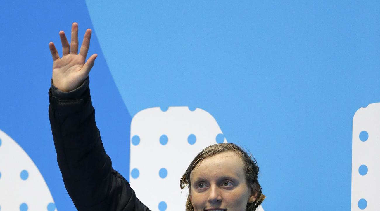 Katie Ledecky waves from the awards stand after winning the women's 200m freestyle at the U.S. swimming national championships in Indianapolis, Wednesday, June 28, 2017. (AP Photo/Michael Conroy)
