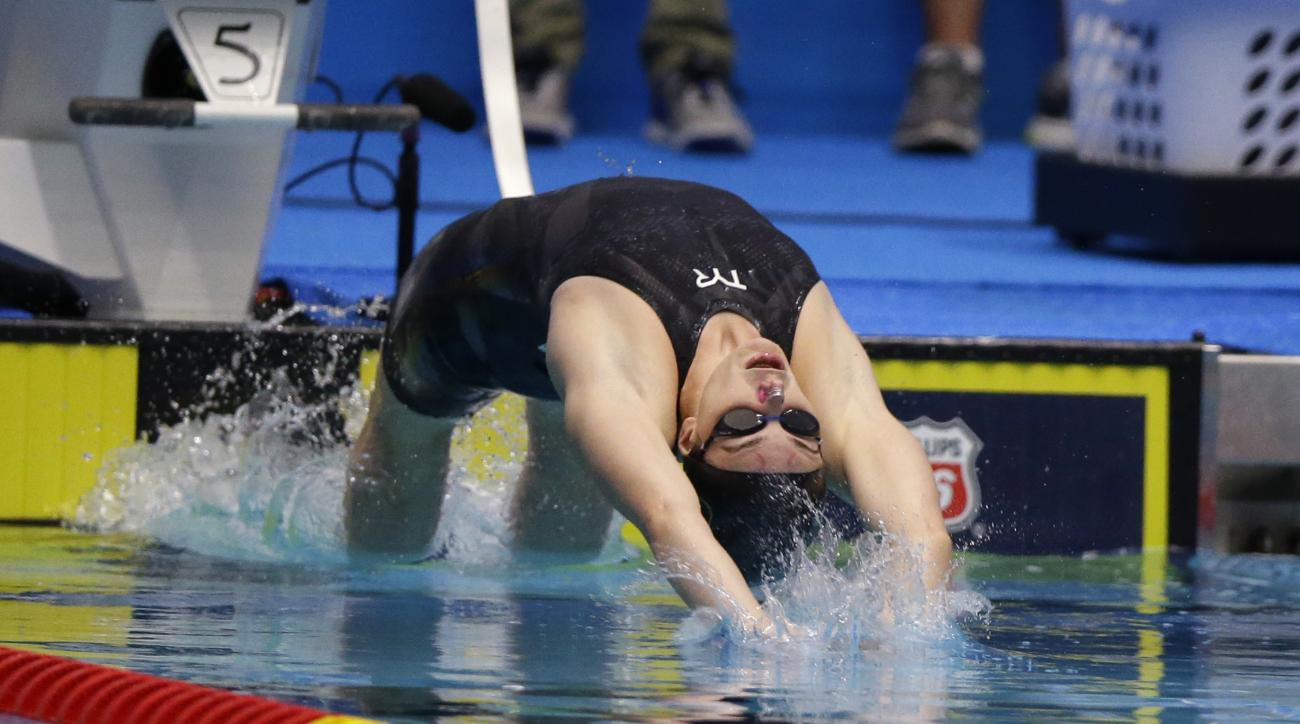 Hannah Stevens starts on her way to winning the women's 50-meter backstroke at the U.S. swimming national championships in Indianapolis, Thursday, June 29, 2017. (AP Photo/Michael Conroy)