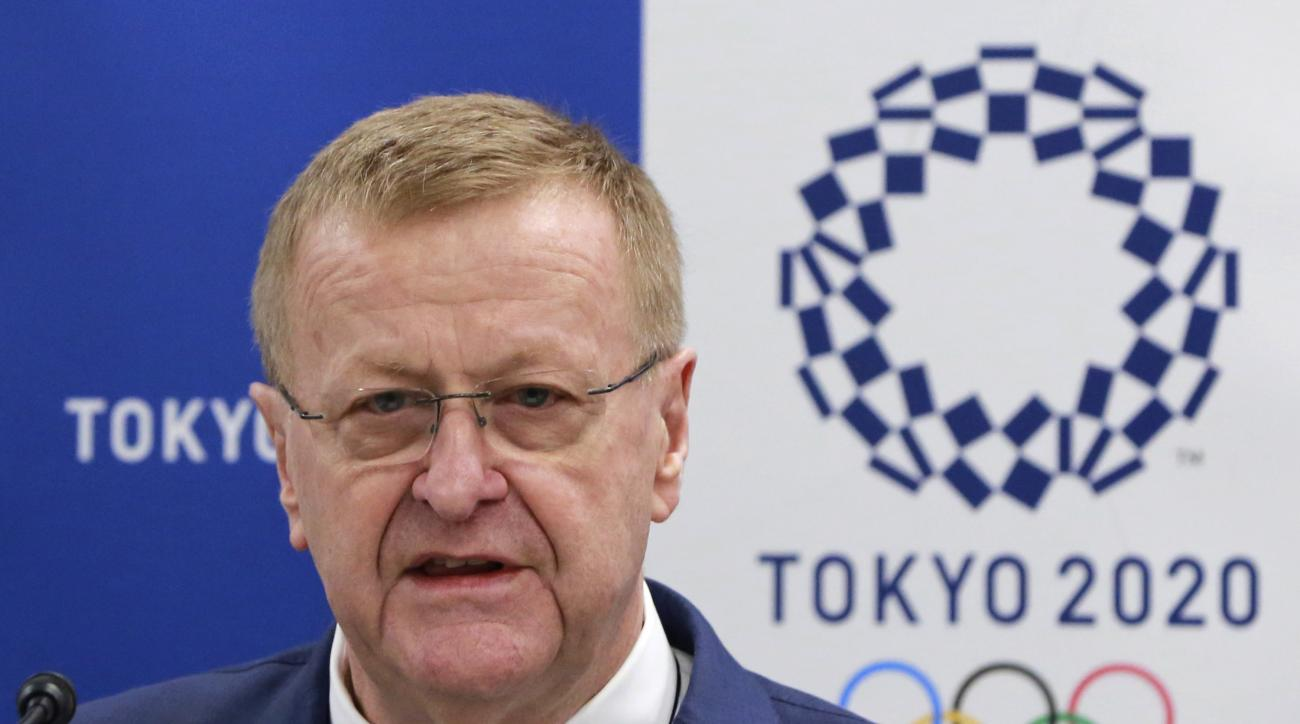 International Olympic Committee (IOC) Vice President John Coates answers questions from a journalist during an IOC-Tokyo 2020 joint press conference in Tokyo Friday, June 30, 2017. Coates said the addition of new sports at the 2020 Tokyo Olympics will att