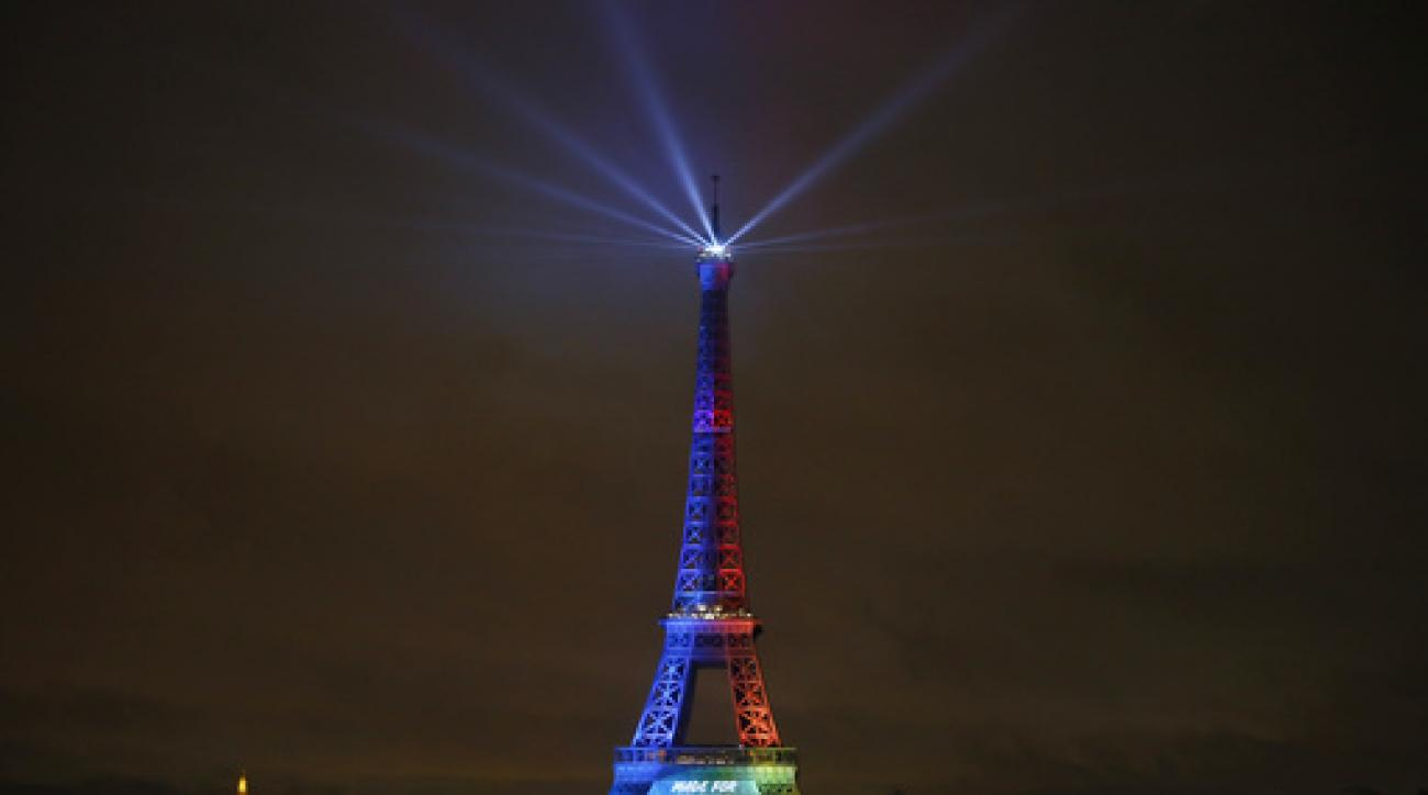 FILE- In this Friday, Feb. 3, 2017 file photo, the Eiffel Tower is lit with colors for the Paris 2024 during the launch of the international campaign of Paris as candidate for the 2024 Olympic summer games in Paris. An International Olympic Committee pane
