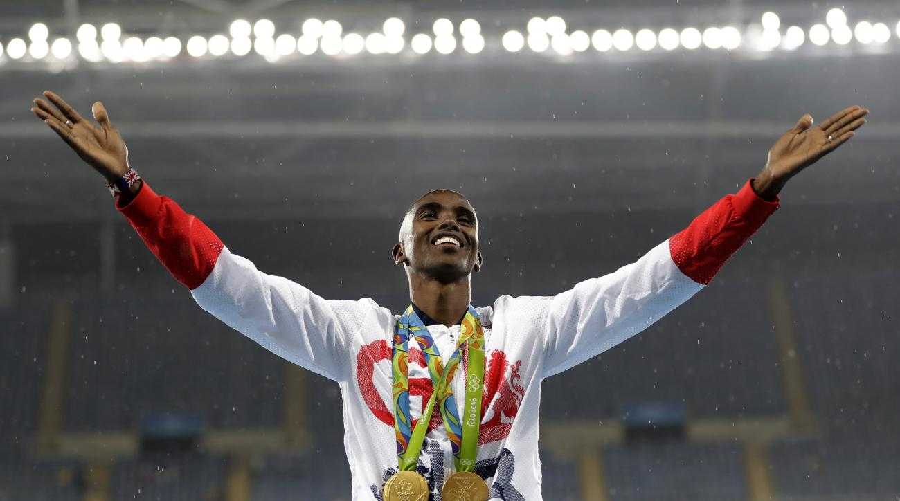 FILE - In this Aug. 20, 2016, file photo, Britain's Mo Farah celebrates winning the gold medal at the men's 5000-meter medals ceremony, during the athletics competitions of the 2016 Summer Olympics at the Olympic stadium in Rio de Janeiro, Brazil. Data po