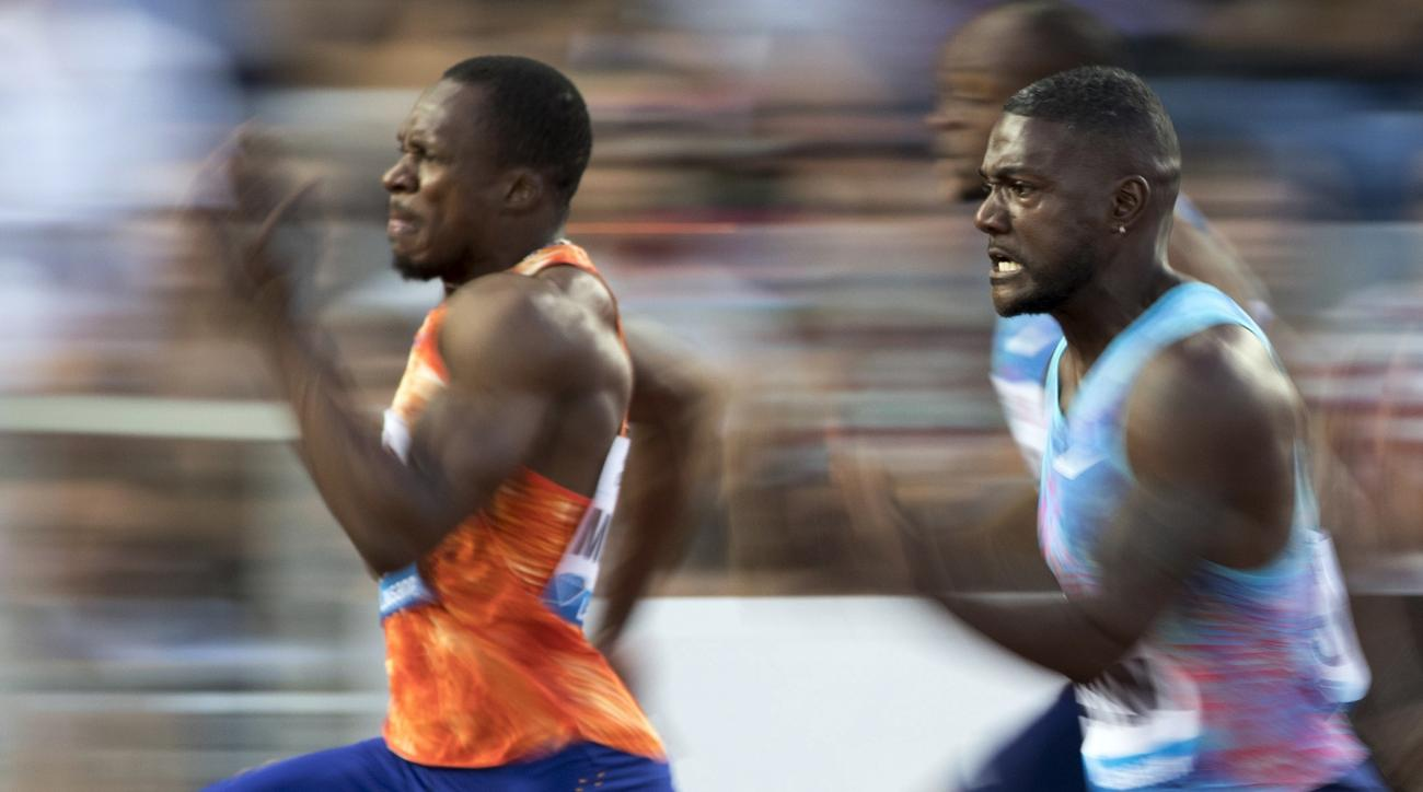 Justin Gatlin,right, from the United States, competes in the men's 100m race at the Athletissima IAAF Diamond League international athletics meeting in the Stade Olympique de la Pontaise in Lausanne, Switzerland, Thursday, July 6, 2017. (Valentin Flauraud