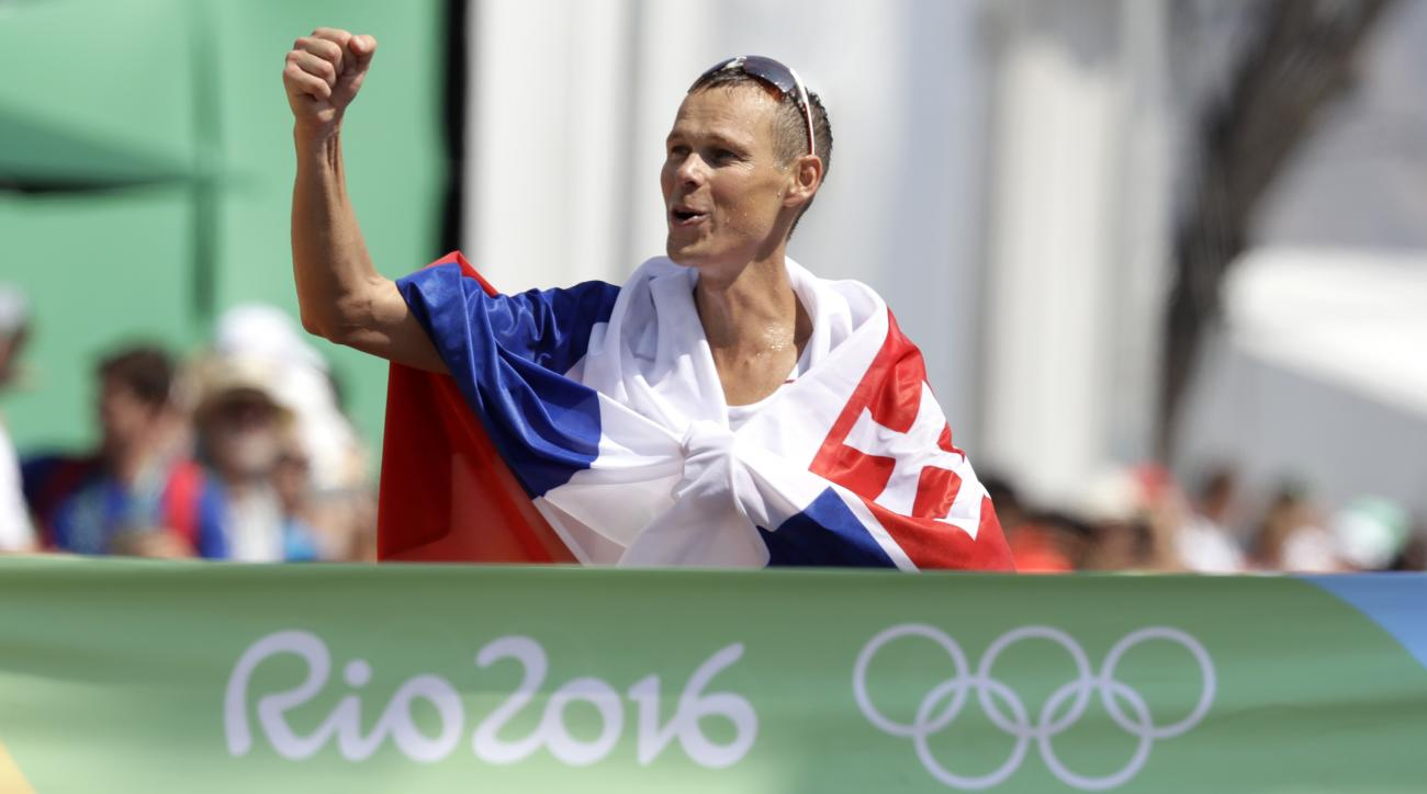 FILE - In this Friday, Aug. 19, 2016 file photo, Slovakia's Matej Toth celebrates after winning the men's 50-km race walk at the 2016 Summer Olympics in Rio de Janeiro, Brazil. The reigning Olympic and world champion in the mens 50-kilometer race-walk, Ma