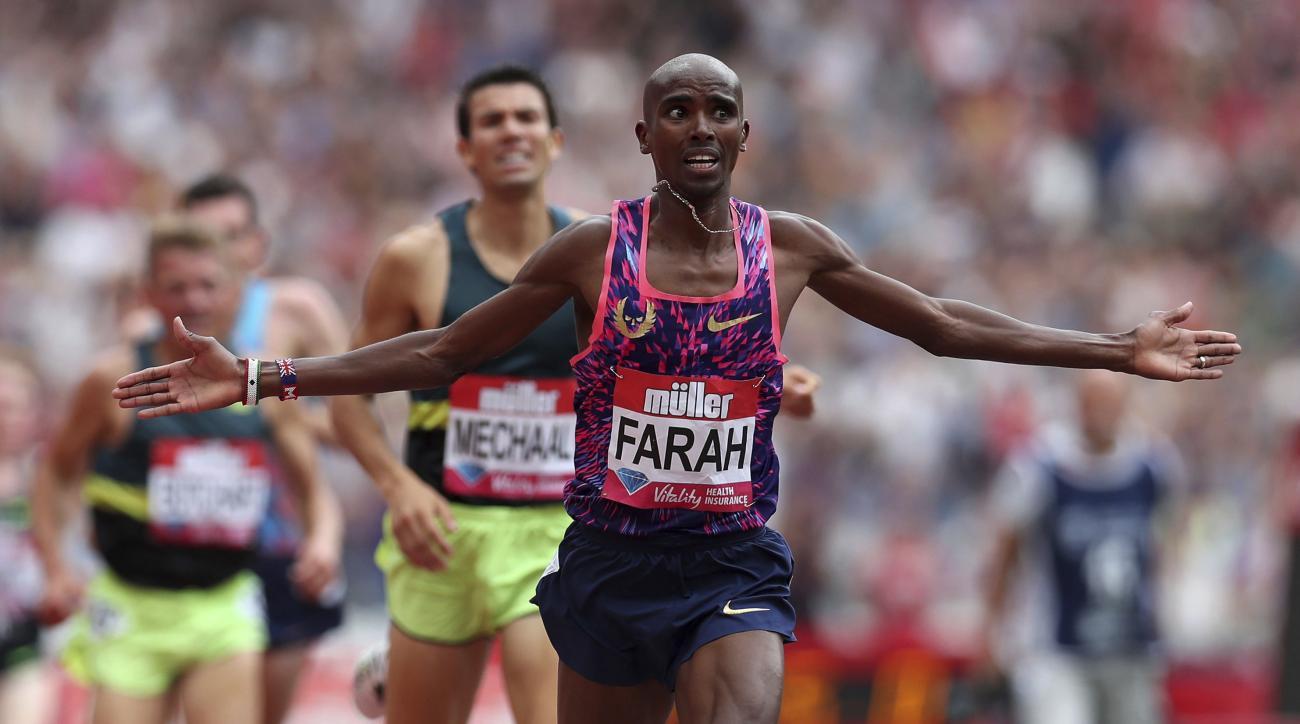 Great Britian's Mo Farah crosses the finish line to win the Men's 3000 metres race during the London Anniversary Games at London Stadium, London, Sunday July 9, 2017. (Chris Radburn/PA via AP)