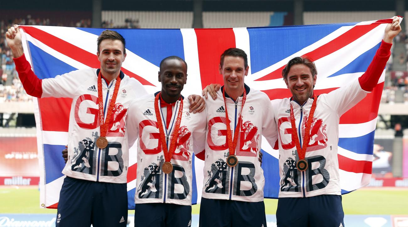 Great Britain's 4x400 metre relay team from the 2008 Olympics, from left, Martyn Rooney, Michael Bingham, Robert Tobin and Andrew Steele celebrate after upgrading to third place and receiving a bronze medal during the London Anniversary Games at London St