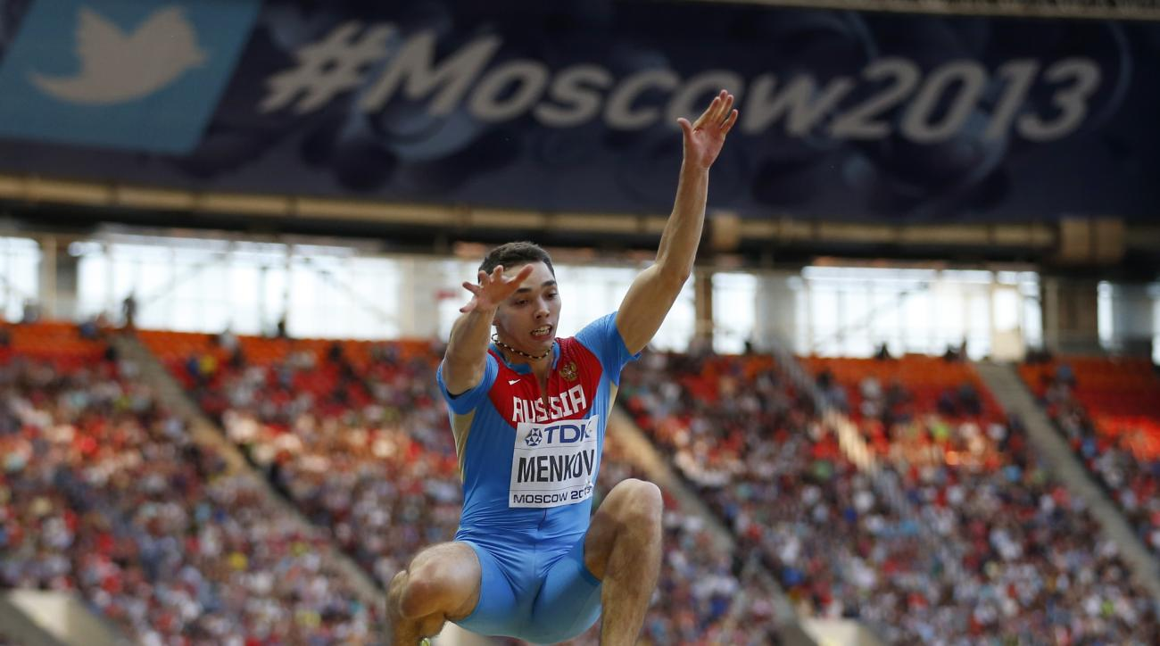 FILE - In this Friday. Aug. 16, 2013 file photo, Russia's Aleksandr Menkov competes in the men's long jump final at the World Athletics Championships in the Luzhniki stadium in Moscow, Russia. Former world long jump world champion Alexander Menkov is amon