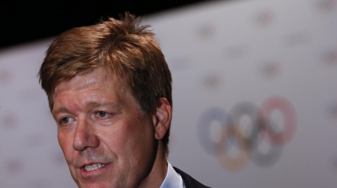 """FILE- In this July 30, 2015 file photo, the IOC medical director Richard Budgett speaks to the Associated Press during an interview in Kuala Lumpur, Malaysia.  Budgett said the Olympic body """"would not hesitate"""" to retest drug samples from the 2014 Winter"""