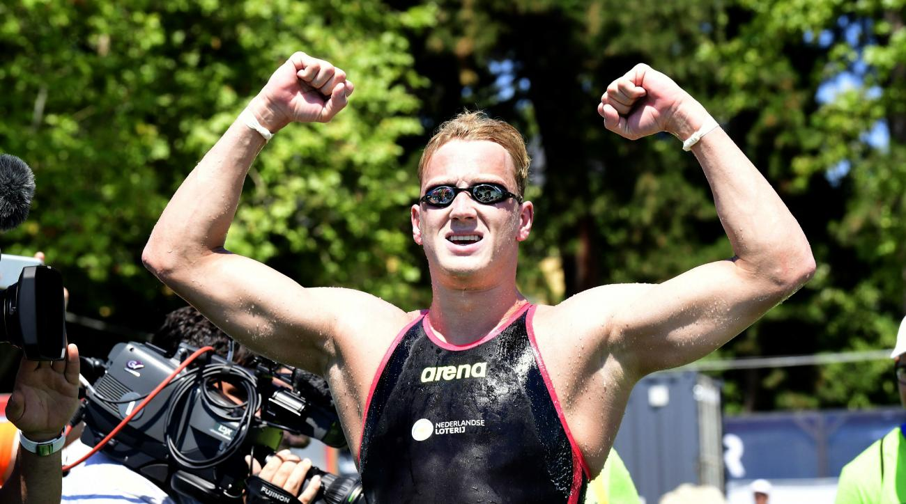 Ferry Weertman of the Netherlands celebrates after he won the gold medal in men's open water 10km final of FINA Swimming World Championships 2017 in Balatonfured, 124 kms southwest of Budapest, Hungary, Tuesday, July 18, 2017. (Zsolt Szigetvary/MTI via AP