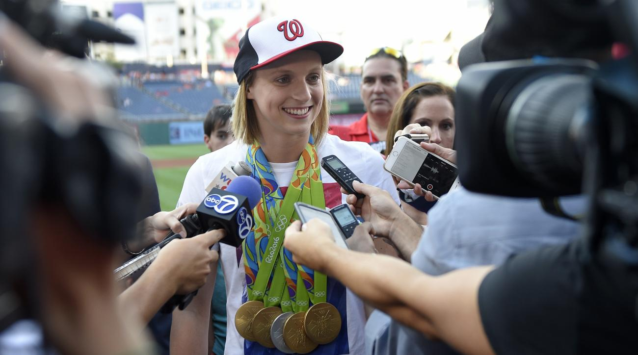 FILE - In this Aug., 24, 2016, file photo, Olympic gold-medal swimmer Katie Ledecky talks to the media before a baseball game between the Baltimore Orioles and the Washington Nationals, in Washington. Ledecky shrugs off the notion that shes doing anything