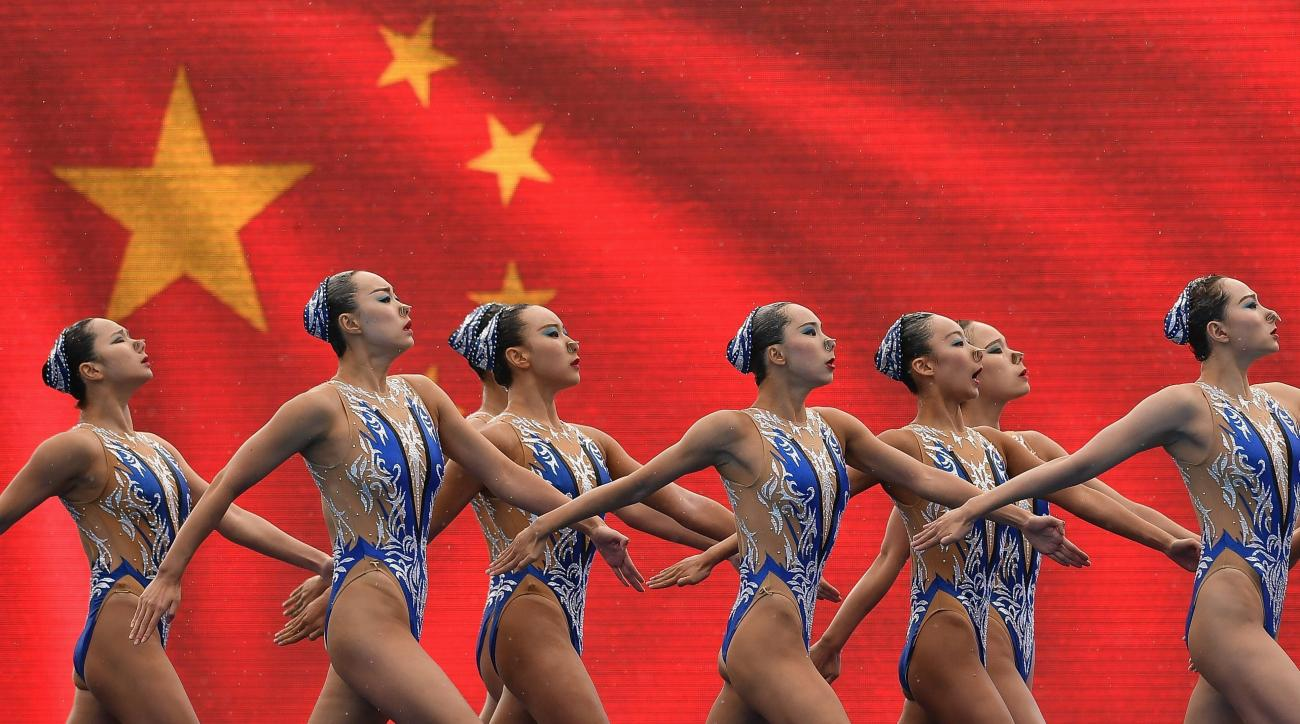 Gold medal winner Team China performs during the women's team free combination synchronized swimming final of the 17th FINA World Championships 2017 in the City Park venue, in Budapest, Hungary, Saturday, July 22, 2017. (Zsolt Czegledi/MTI via AP)