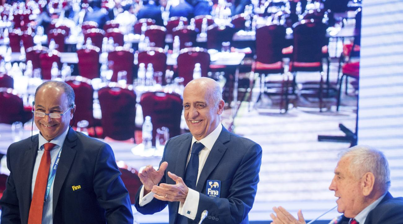 From left: International Swimming Federation, FINA Vice-President, Husain Al Musallam, President of FINA Julio Cesar Maglione and Executive Director of FINA, Cornel Marculescu are seen during the press conference after the FINA's congress at Hotel InterCo
