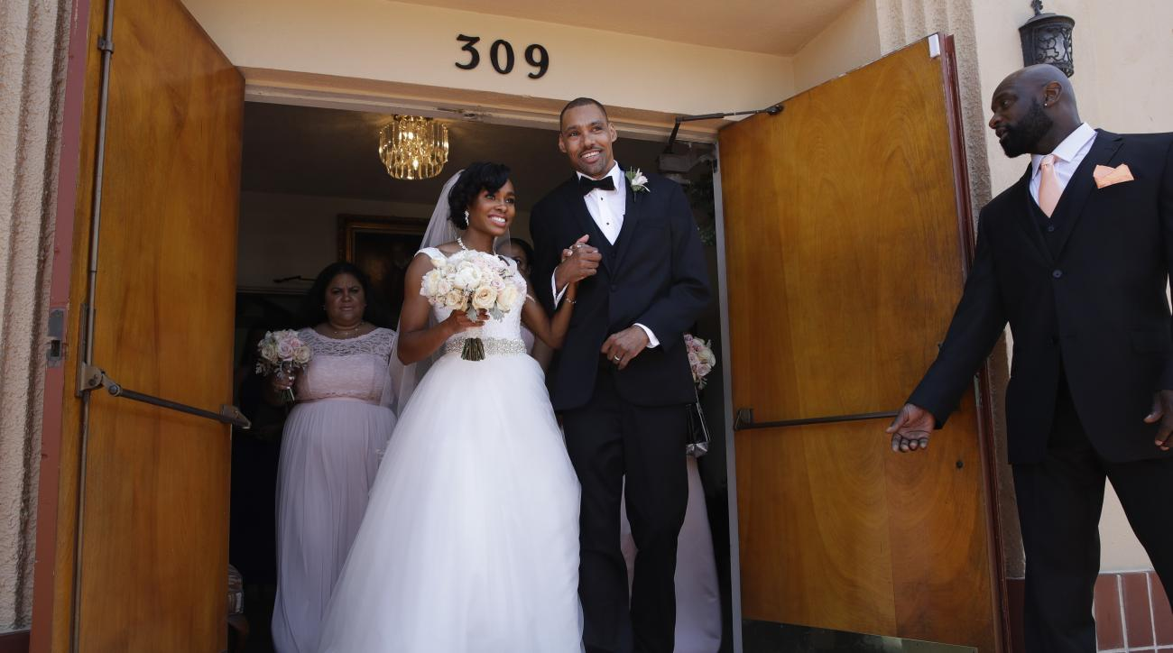 Two-time Olympic jumper Jamie Nieto, center right, and his bride Shevon Stoddart, a Jamaican hurdler, walks out of a church after their wedding ceremony Saturday, July 22, 2017, in El Cajon, Calif. Step by halting step, Nieto made good on his vow to walk