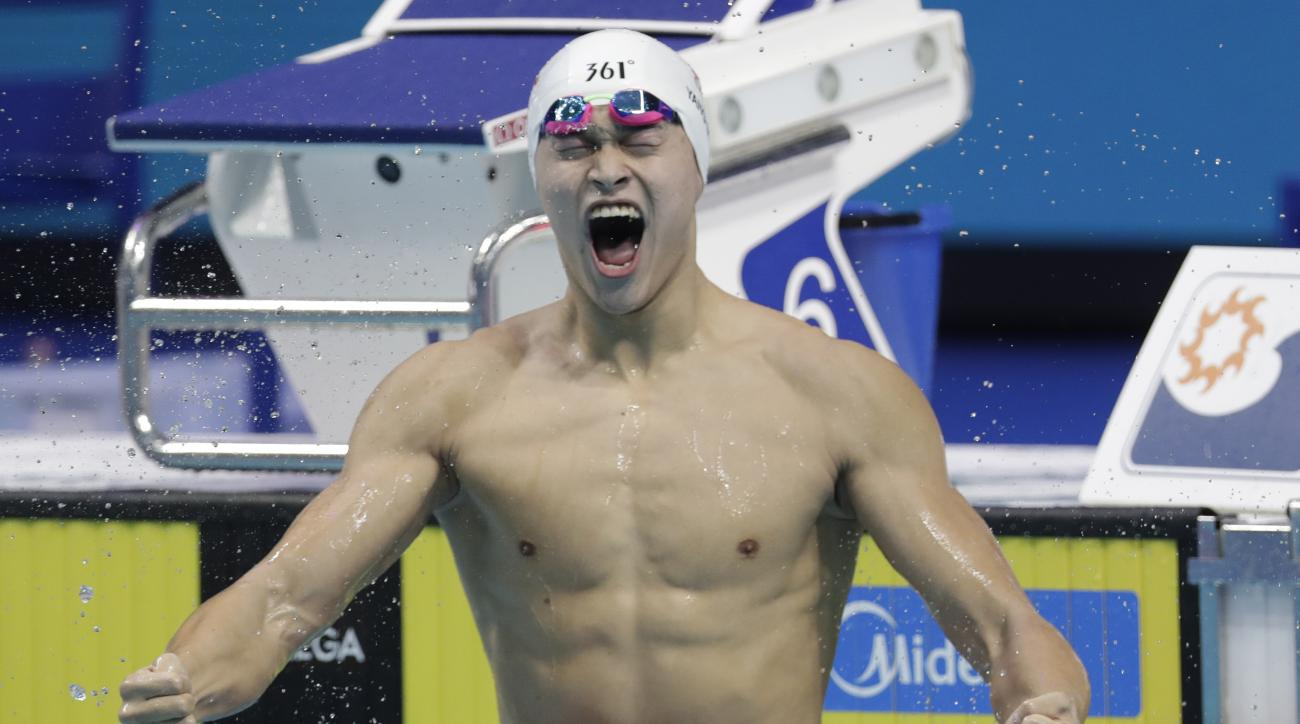 China's Sun Yang celebrates after winning the gold medal in the men's 400-meter freestyle final during the swimming competitions of the World Aquatics Championships in Budapest, Hungary, Sunday, July 23, 2017. (AP Photo/Michael Sohn)