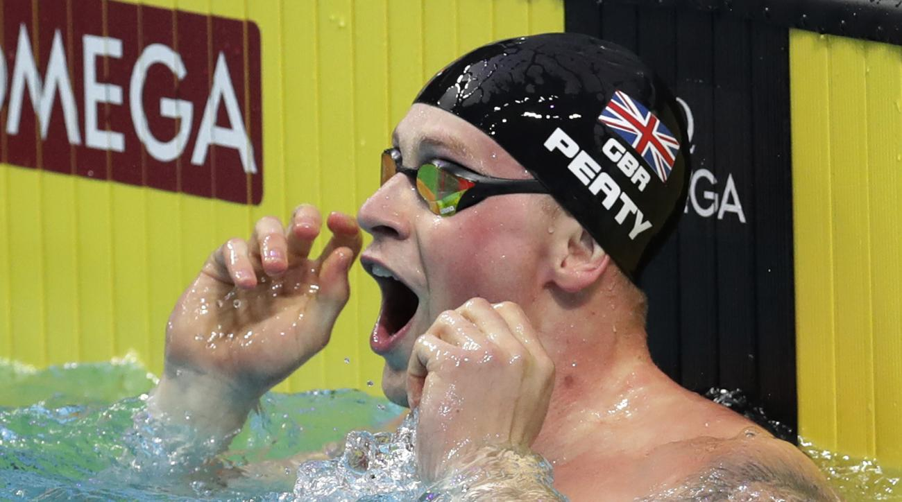 Britain's Adam Peaty celebrates after setting a new world record in a men's 50-meter breaststroke semifinal during the swimming competitions of the World Aquatics Championships in Budapest, Hungary, Tuesday, July 25, 2017. (AP Photo/Michael Sohn)