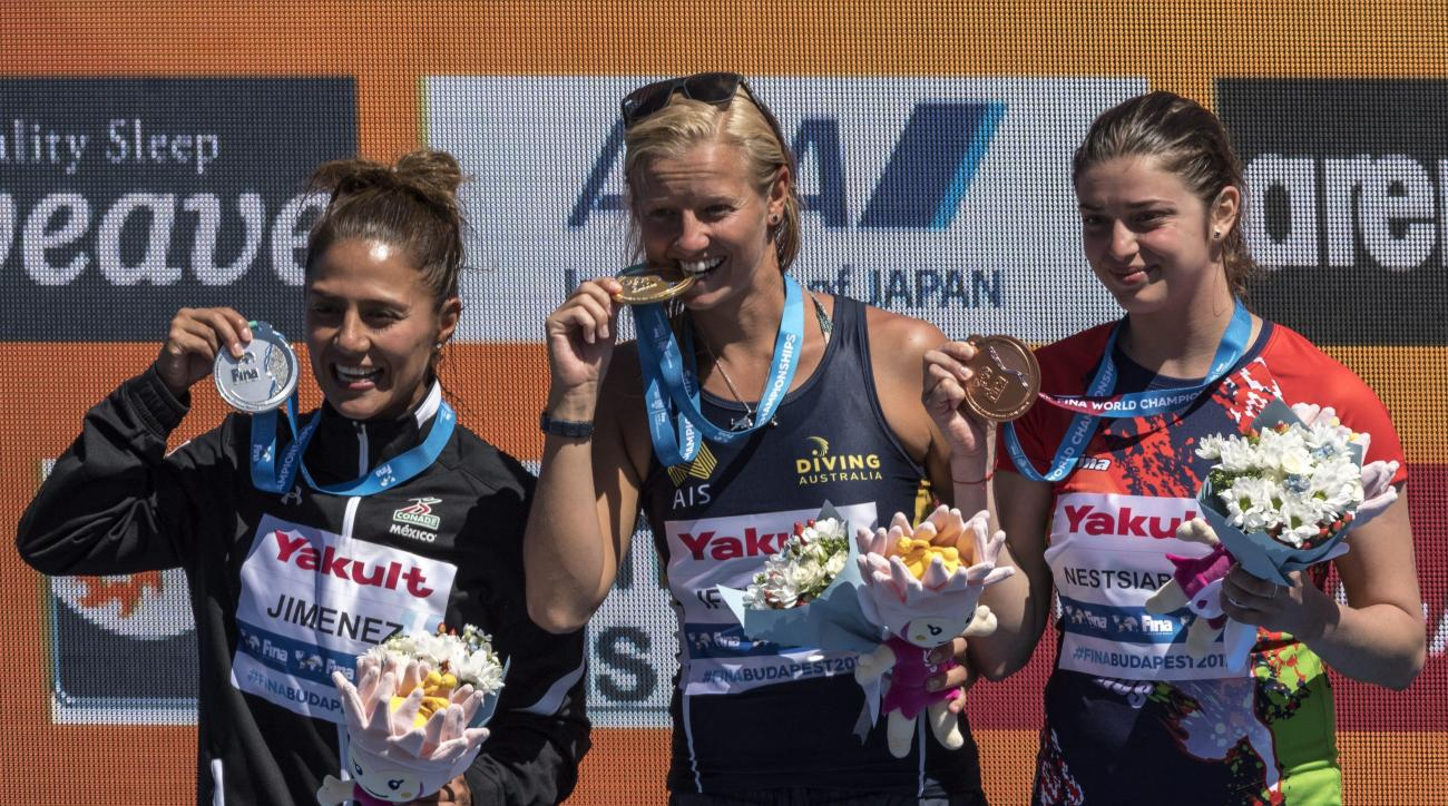 From left to right: silver medalist Adriana Jimenez of Mexico, gold medalist Rhiannan Iffland of Australia and bronze medalist Yana Nestsiarava of Belarus pose with their medals during the award ceremony of women's high diving final of the 17th FINA Swimm