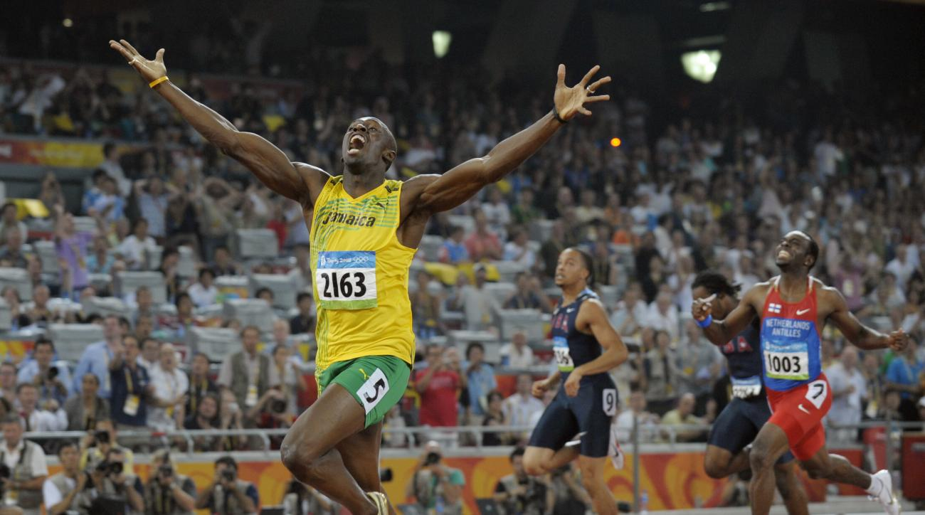 FILE - In this Aug. 20, 2008, file photo, Jamaica's Usain Bolt celebrates as he wins the men's 200-meter final with a world record during the athletics competitions in the National Stadium at the Beijing 2008 Olympics, in Beijing. The man who reshaped the
