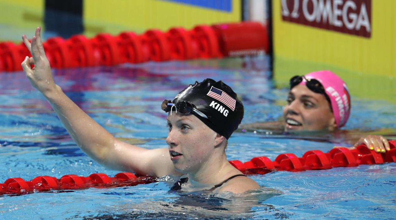 United States' Lilly King celebrates in front of Russia's Yuliya Efimova, right, after setting a new world record in the women's 50-meter breaststroke final during the swimming competitions of the World Aquatics Championships in Budapest, Hungary, Sunday,