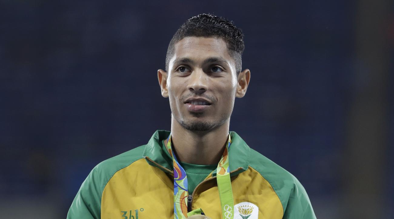 FILE - In this Monday, Aug. 15, 2016 file photo, South Africa's Wayde Van Niekerk holds up his gold medal during the medal ceremony for the men's 400-meter final during the athletics competitions of the 2016 Summer Olympics at the Olympic stadium in Rio d