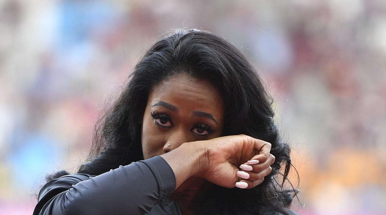 Francena McCorory of the United Sates wipes away a tear after she received her bronze medal during a ceremony at the World Athletics Championships in London Friday, Aug. 4, 2017. McCorory originally finished fourth in the women's 400m at the World Champio
