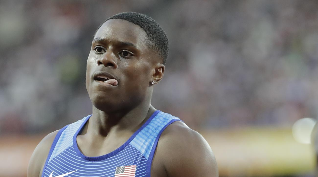 United States' Christian Coleman walks off after winning a Men's 100m first round heat during the World Athletics Championships in London Friday, Aug. 4, 2017. (AP Photo/David J. Phillip)