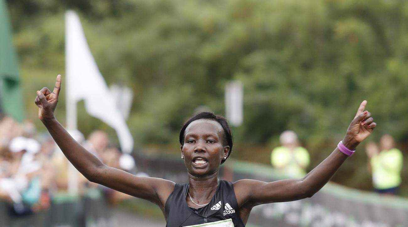 Mary Keitany, 25, of Kenya, crosses the finish line to win the women's division of the 20th annual TD Beach To Beacon 10K road race Saturday, Aug. 5, 2017 in Cape Elizabeth, Maine. (AP Photo/Joel Page)