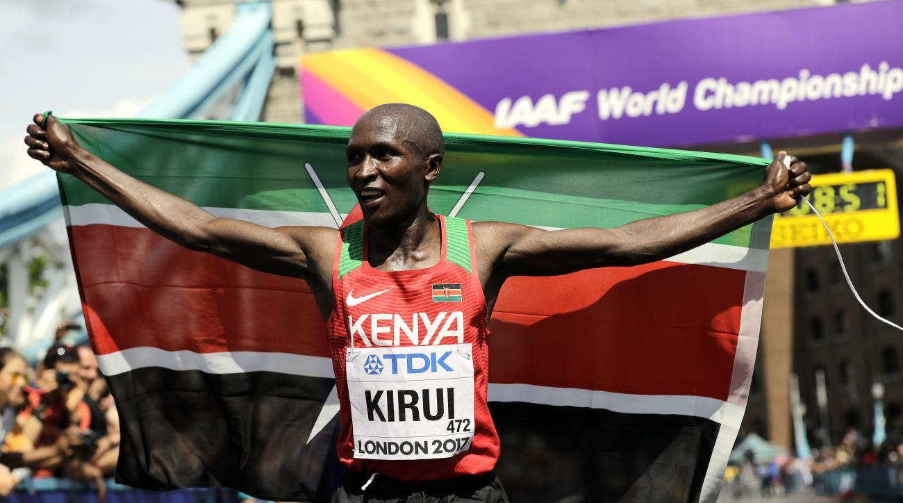 Kenya's Geoffrey Kipkorir Kirui celebrates after winning the gold medal in the Men's Marathon during the World Athletics Championships Sunday, Aug. 6, 2017.(AP Photo/Tim Ireland)