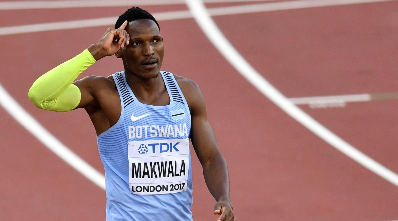 Botswana's Isaac Makwala reacts after winning his heat of the Men's 400 meters during the World Athletics Championships in London Sunday, Aug. 6, 2017. (AP Photo/Martin Meissner)