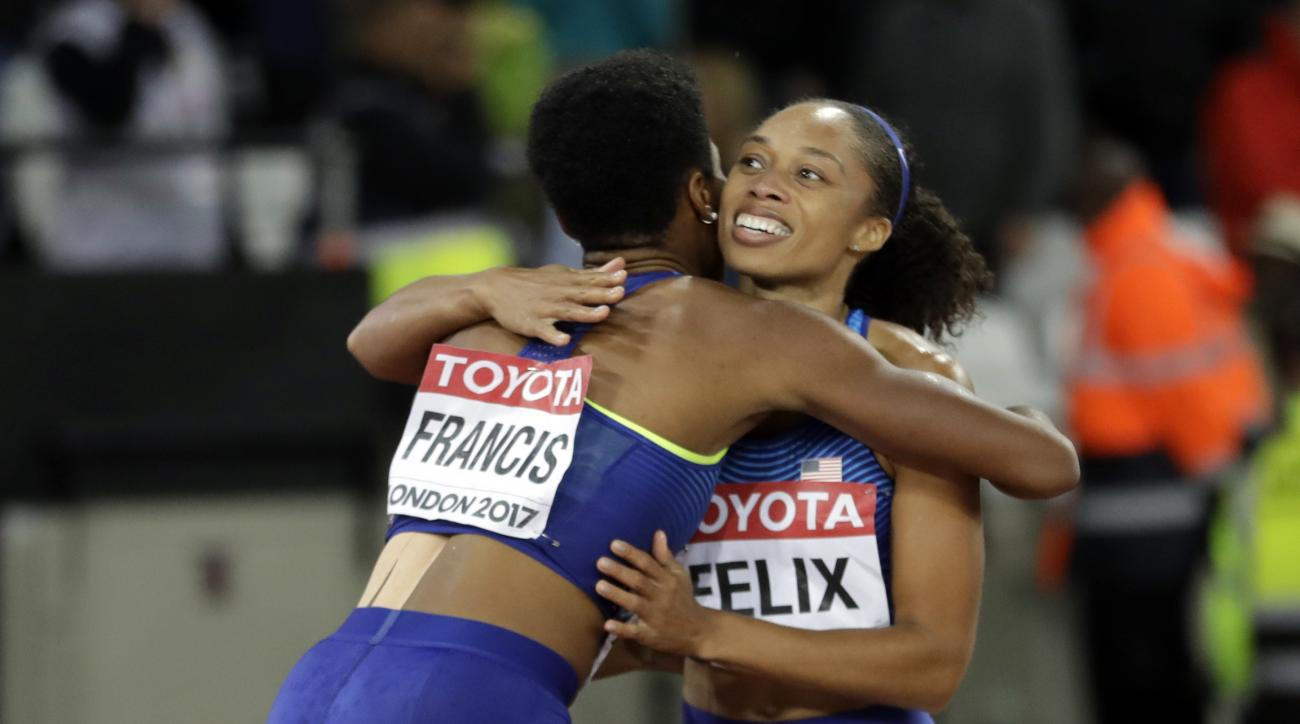 United States' bronze medal winner Allyson Felix, right, congratulates United States' gold medal winner Phyllis Francis, left, after the women's 400-meter final during the World Athletics Championships in London Wednesday, Aug. 9, 2017. (AP Photo/Matthias