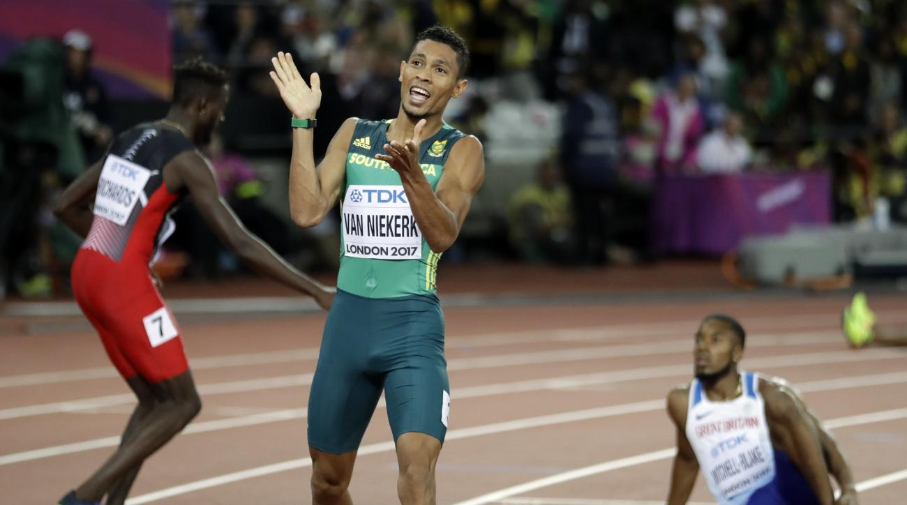 South Africa's Wayde van Niekerk celebrates after winning the bronze medal after the men's 200-meter final during the World Athletics Championships in London Thursday, Aug. 10, 2017. (AP Photo/Matthias Schrader)