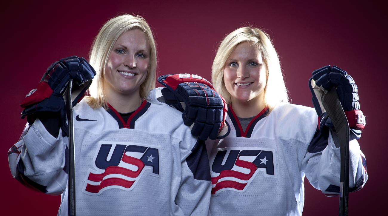 FILE - In this Oct. 2, 2013, file photo, United States Olympic Winter Games Hockey players Jocelyne Lamoureux, left, and Monique Lamoureux pose for a portrait at the Team USA Media Summit in Park City, Utah. Monique Lamoureux-Morando and twin sister Jocel