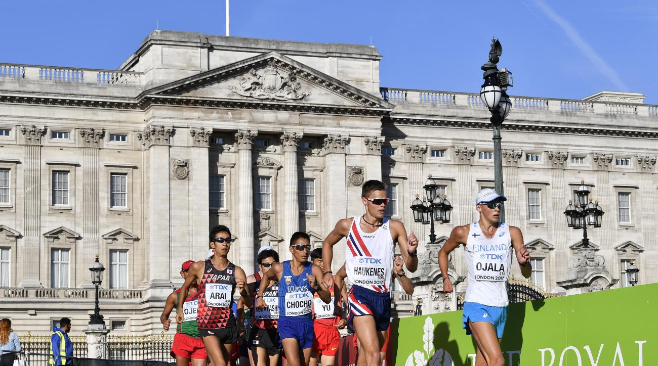 Finland's Veli-Matti Partanen, Norway's Havard Haukenes, Ecuador's Andres Chocho and Japan's Hirooki Arai, from right, pass by Buckingham Palace as they compete in the men's 50-kilometer race walk during the World Athletics Championships in London Sunday,