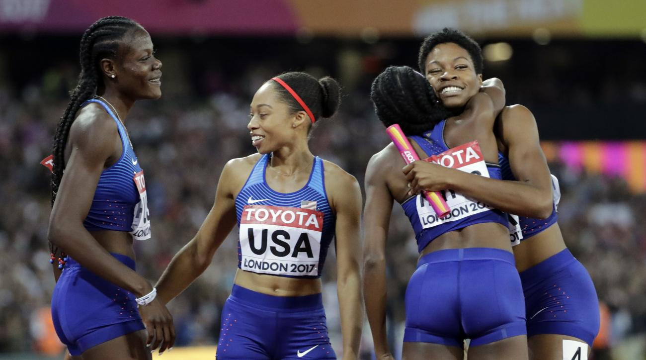 The gold medal winning US relay team, from left, Shakima Wimbley, Allyson Felix Quanera Hayes and Phyllis Francis celebrate after the women's 4x400-meter relay final during the World Athletics Championships in London Sunday, Aug. 13, 2017. (AP Photo/David