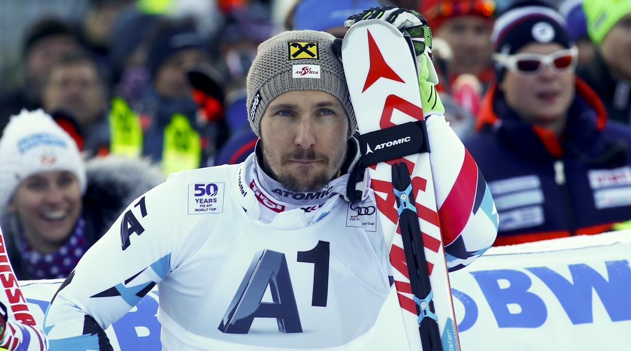 FILE - In this Jan. 22, 2017 file photo Austria's Marcel Hirscher waits in the finish area during an alpine ski, men's World Cup slalom, in Kitzbuehel, Austria. Multiple World Cup Overall winner Hirscher broke his left ankle during a training on Moelltale
