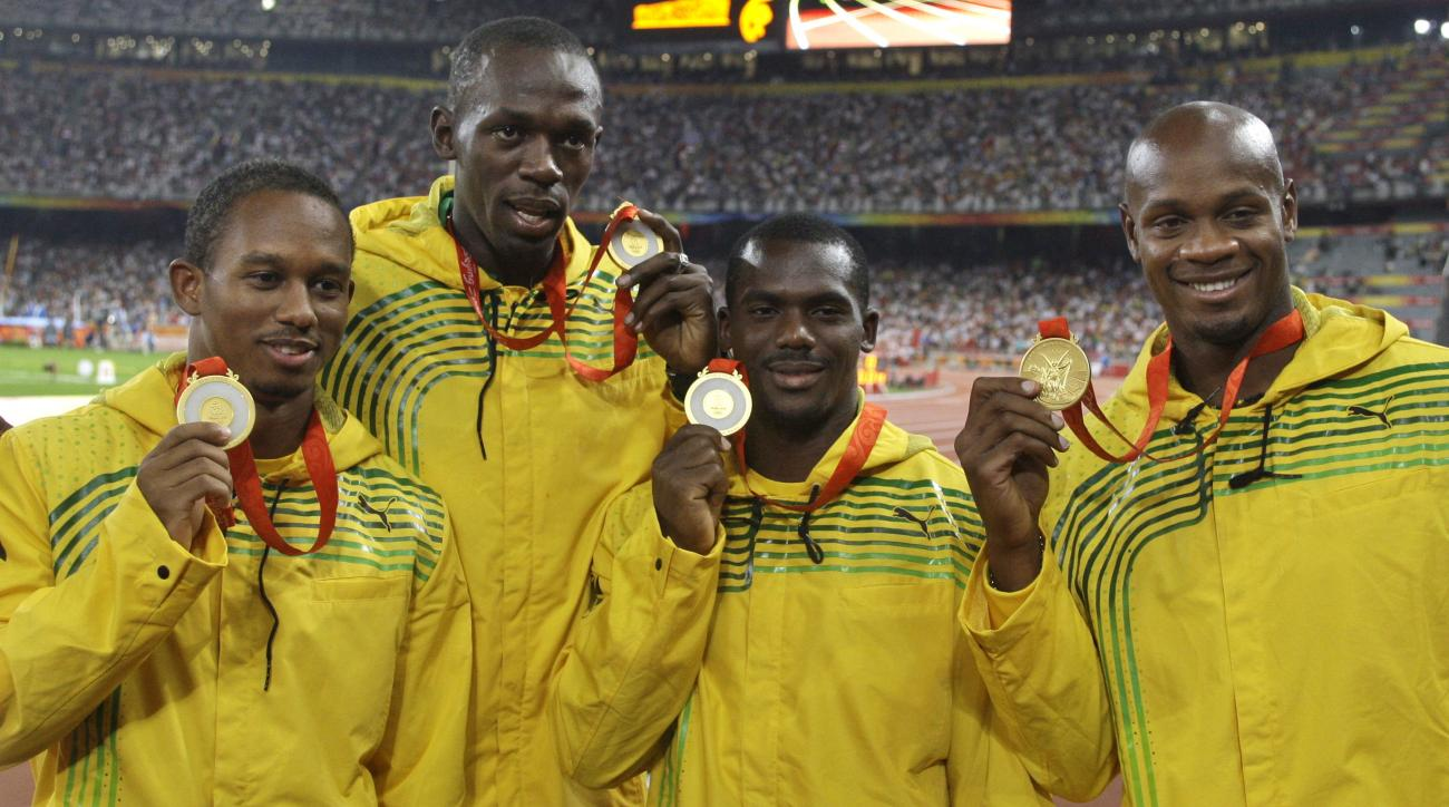 FILE - In this Saturday, Aug. 23, 2008 file photo, Jamaica's men's 4x100 meters relay team, from left, Michael Fraser, Usain Bolt, Nesta Carter and Asafa Powell show their gold medals during the athletics competitions in the National Stadium at the Beijin