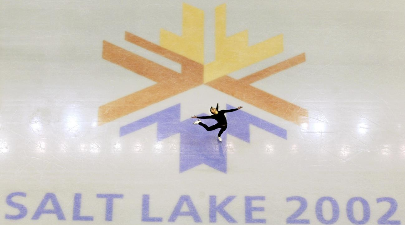 FILE - This Feb. 8, 2002 file photo shows U.S. champion Michelle Kwan practicing for the women's short program for the Winter Olympic Games at the Salt lake Ice Center in Salt Lake City. There's an outside shot the United States won't have to wait 11 year
